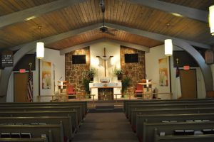 Service Hours and photo of Church Sanctuary or Worship Service area