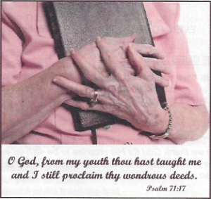 08-24-14-An-Elderly-Person-Clinging-To-Their-Bible-image